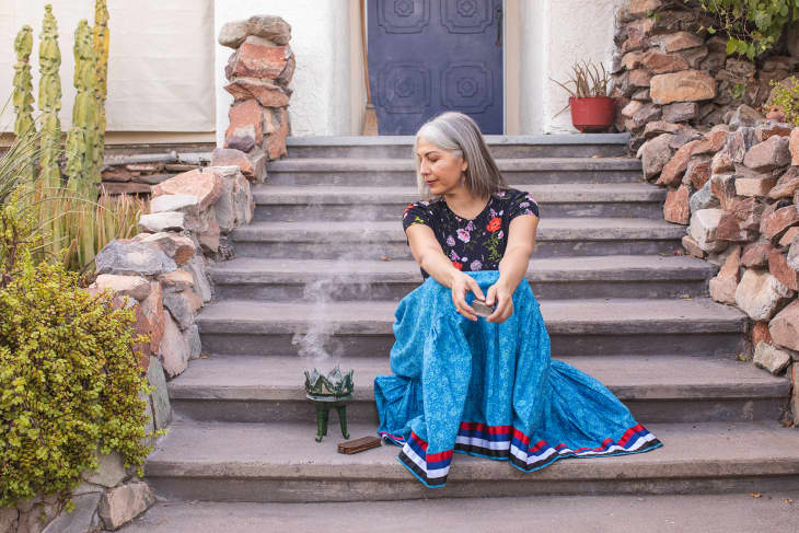 Felicia with burning copal and palo santo on her steps