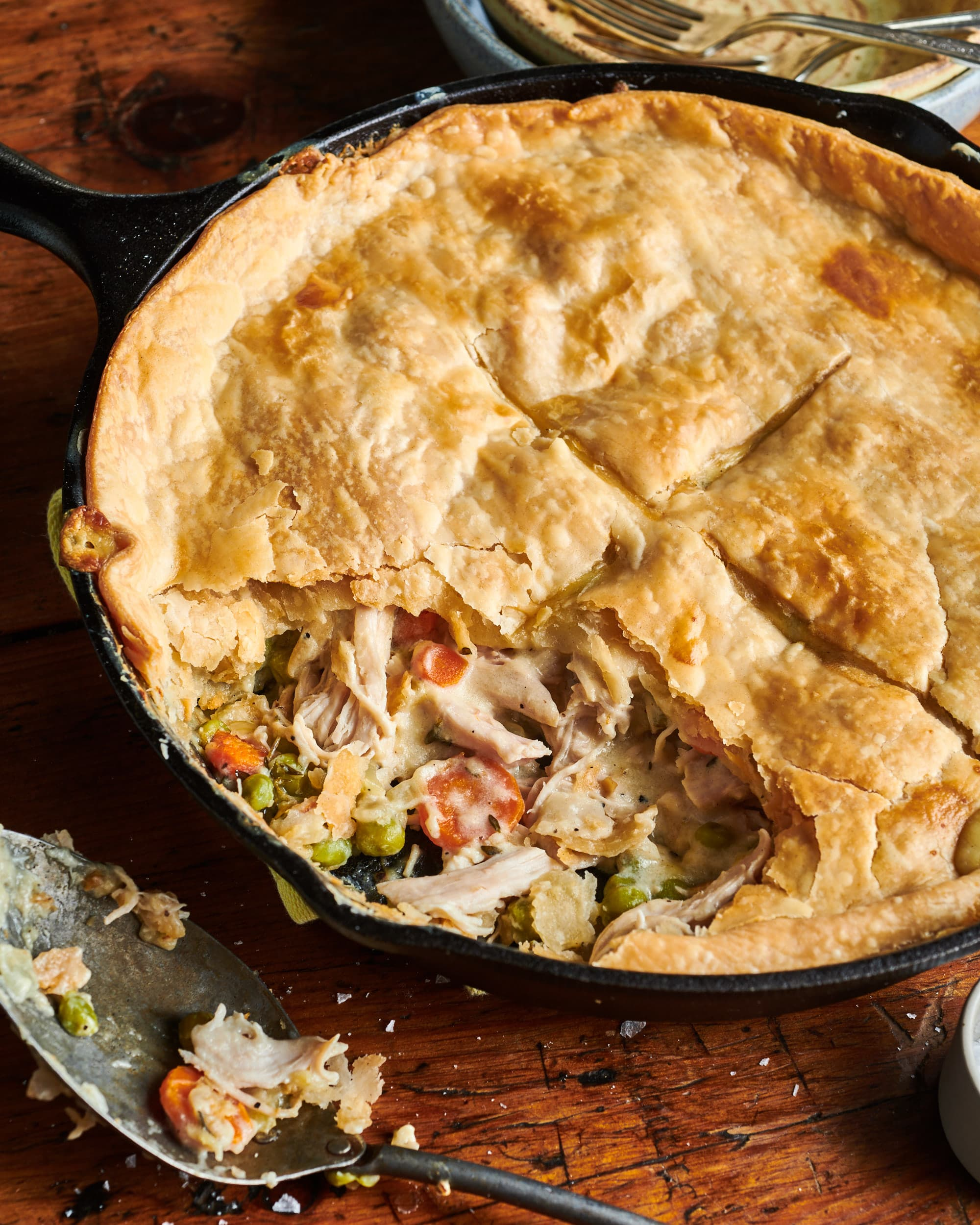 Turkey pot pie in skillet with portion sliced out.