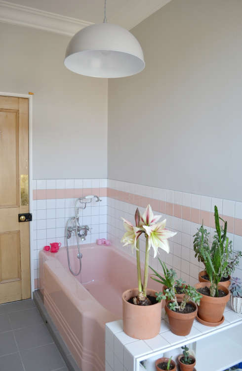 How to tone down or play up pink vintage bathroom tile - How to put down tile in bathroom ...