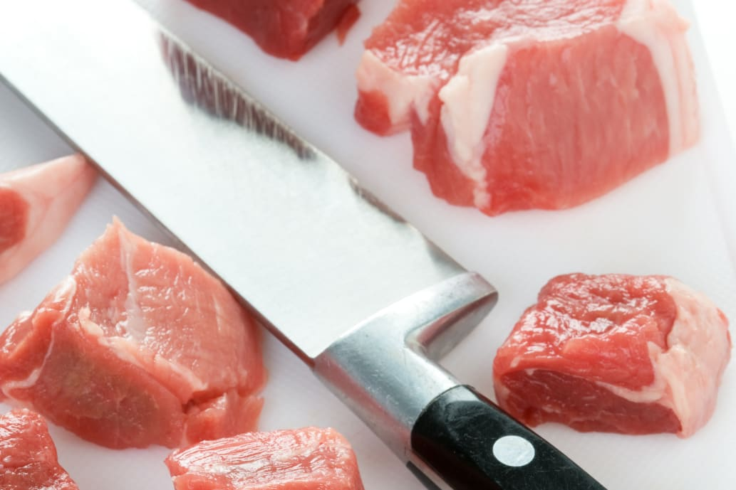 Plastic cutting board for raw meat