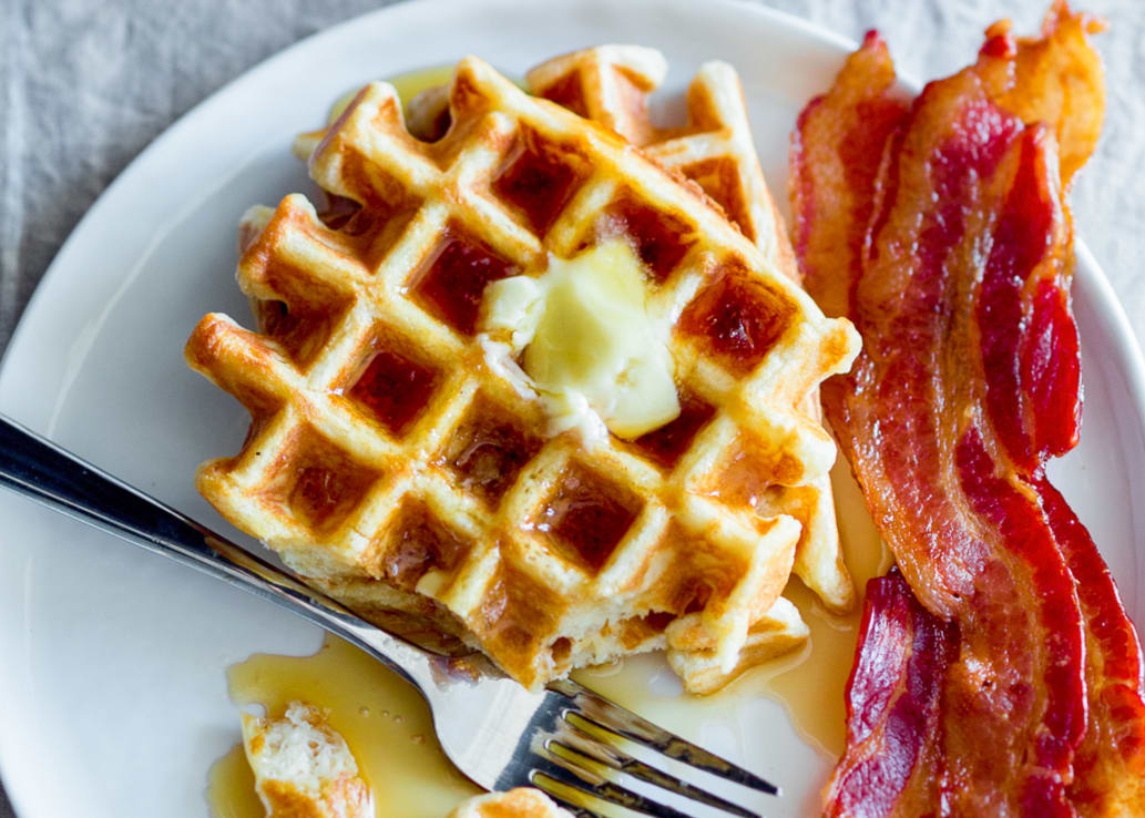 Waffles and bacon on a plate