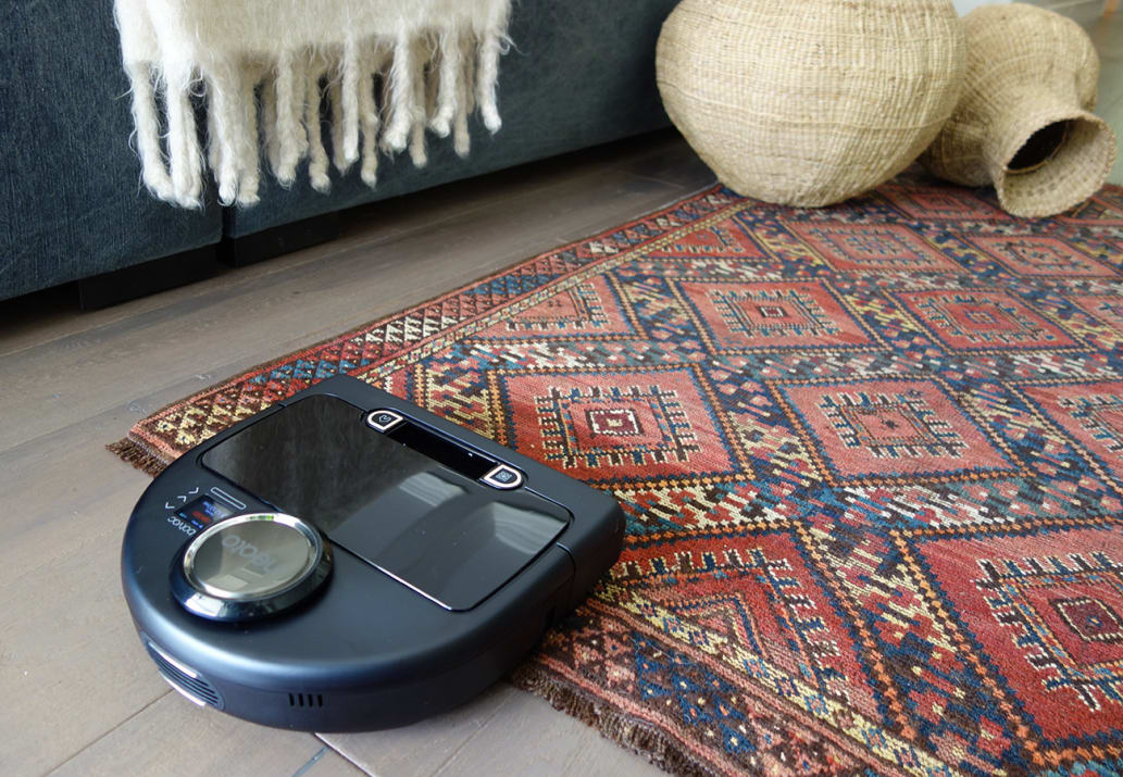 Neato Robotics Botvac vacuuming an area rug.