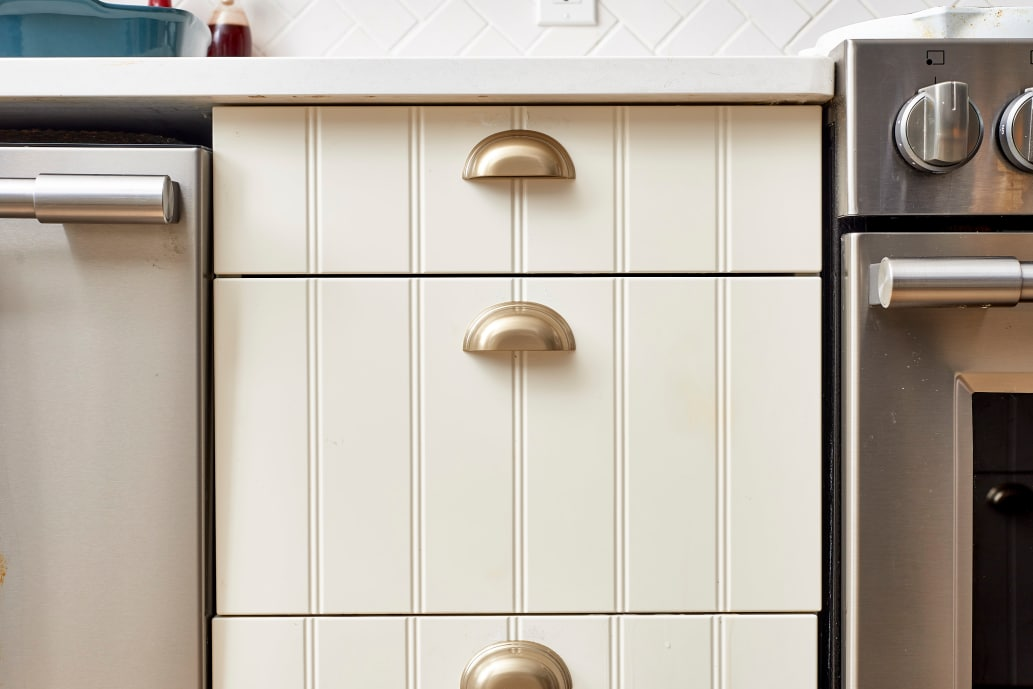 how to clean sticky wood cabinets