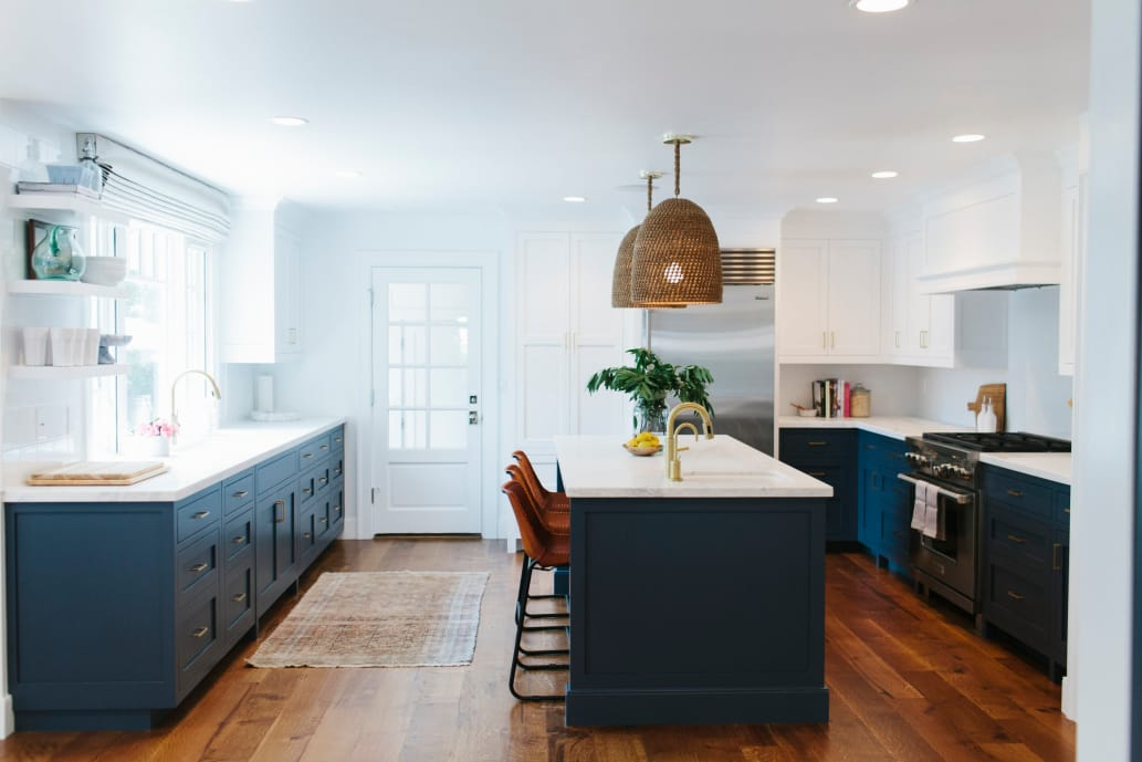 navy kitchen cabinets and woven pendant lamp