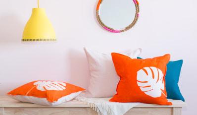 yellow lamp, mirror, sun print orange pillows diys