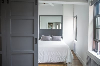 How To Make A Small Bedroom Feel Bigger | Apartment Therapy How To Make A Small Bedroom Feel Bigger on ways to make a vaulted ceiling bedroom appear bigger, ideas to make room bigger, make small bathroom look bigger, make the most out of a small bedroom,