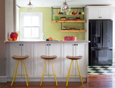 Farmhouse kitchen with yellow metal bar stools