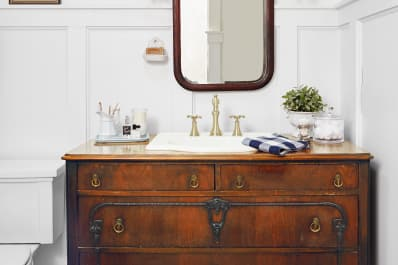 vintage dresser used as bathroom vanity with sink