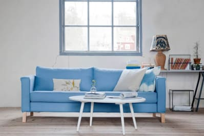 Blue Slipcover On IKEA Couch And White Coffee Table