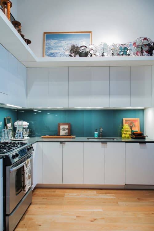 Charmant Back Painted Glass Panels Add A Pop Of Teal To This Loft Kitchen In New  Jersey.