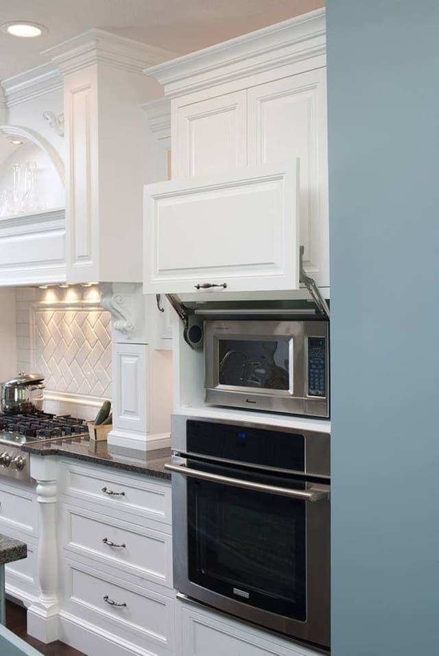 When the microwave is not in use, it can easily hide behind the door, offering a minimalist look to your kitchen cabinetry.