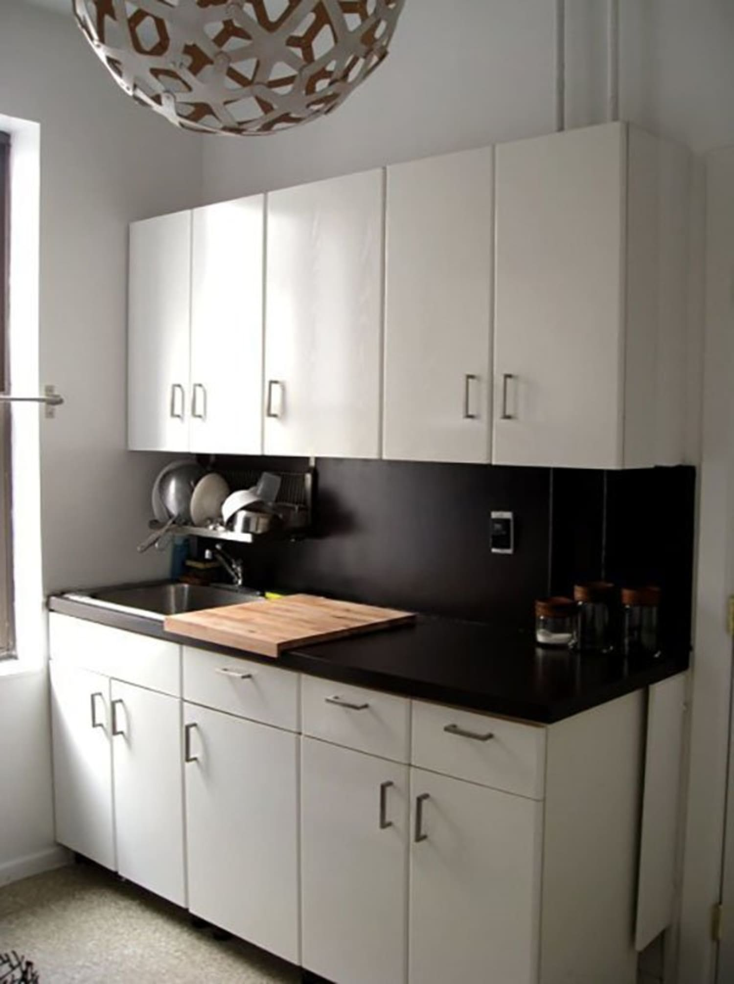 10 Ways We've Disguised Ugly Rental Kitchen Countertops | Kitchn Ideas For Ugly Kitchen Cabinets on ideas for ugly walls, ideas for ugly fireplaces, ideas for ugly fences, ideas for ugly bookshelves,