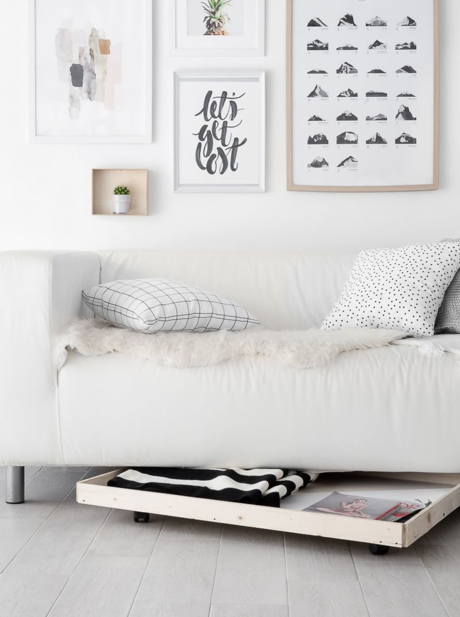 9 Ways To Add Storage Using The Area Under Your Sofa