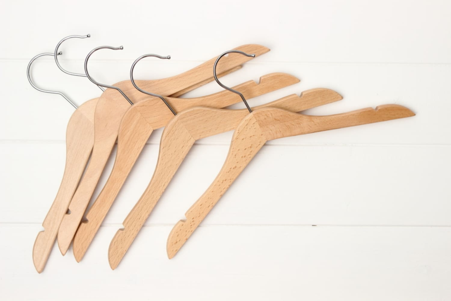 Where To Buy a Whole Bunch of Wooden Hangers Without Going Broke