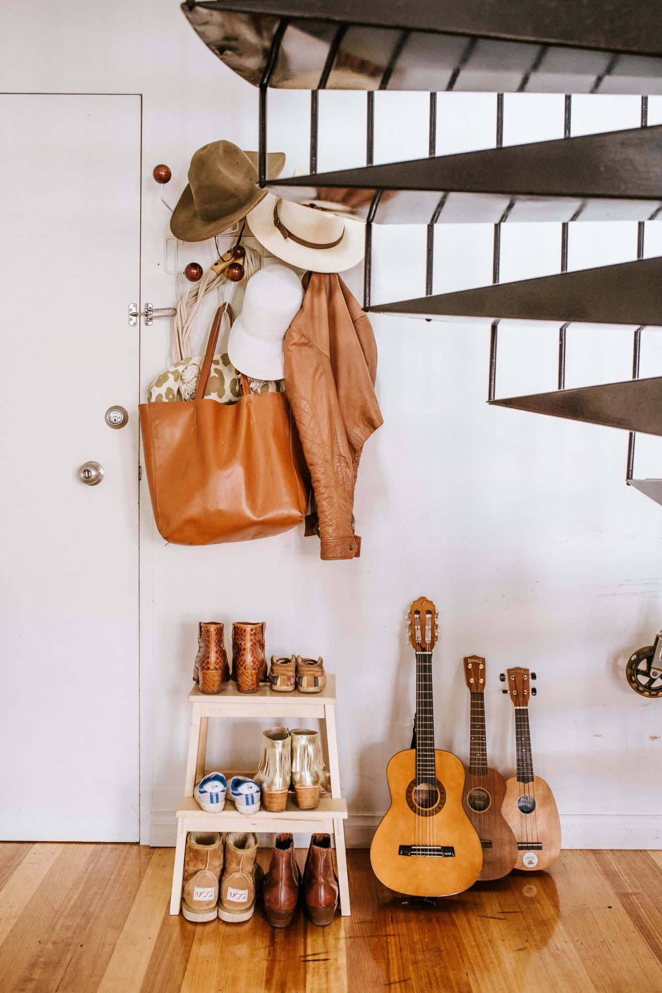 Shoes, purse, hat, and coatrack
