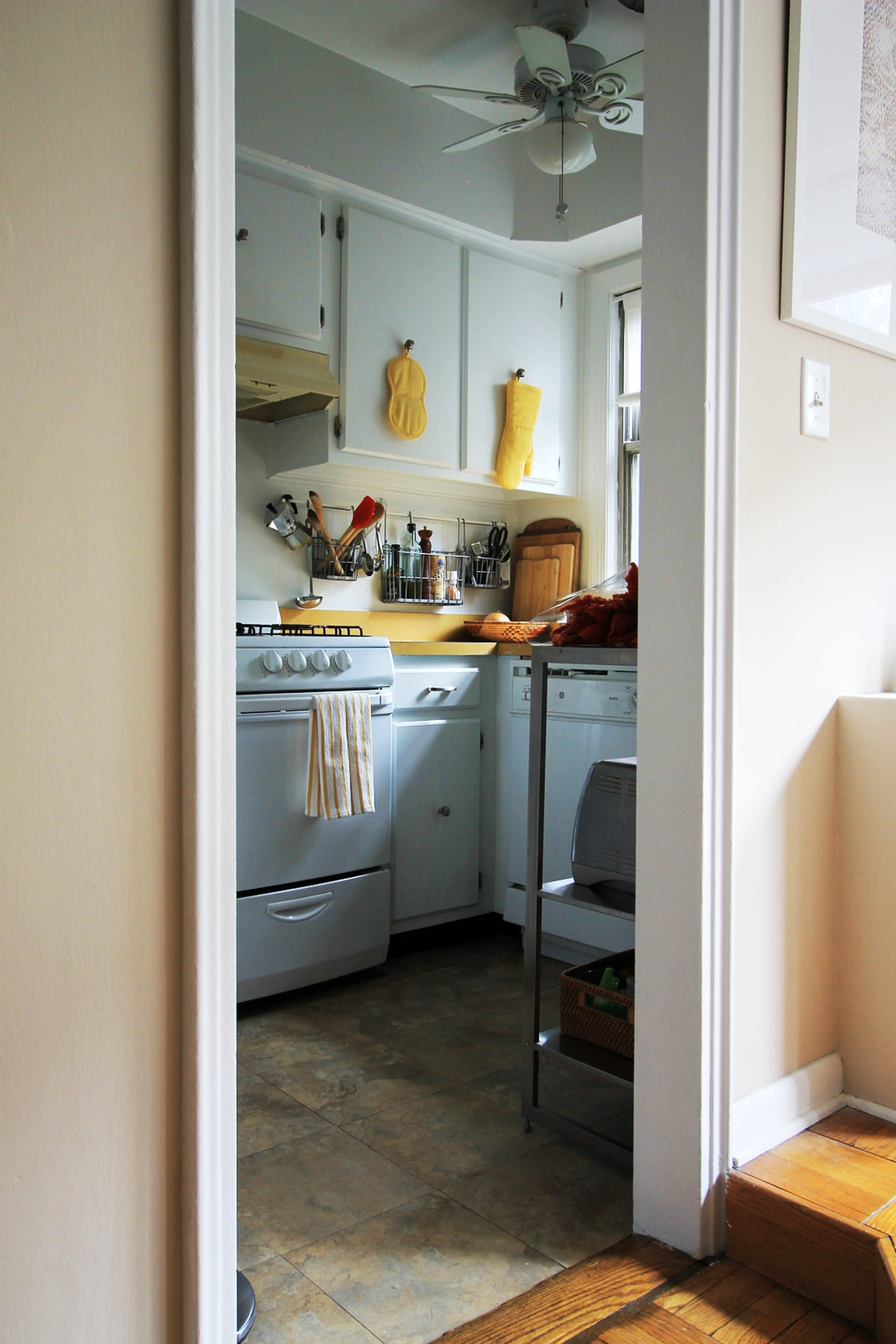 4 Pro Designers Share Their Best Tricks for Improving a Rental ... Mismatched Kitchen Cabinets With Addition on kitchen with mismatched appliances, different styles of kitchen cabinets, mixed kitchen cabinets, different colored kitchen cabinets, kitchen with mixed wood colors, kitchens with painted and stained cabinets, kitchen addition ideas, mixed wood cabinets, kitchen with mismatched tile, kitchen cabinet glass front doors,