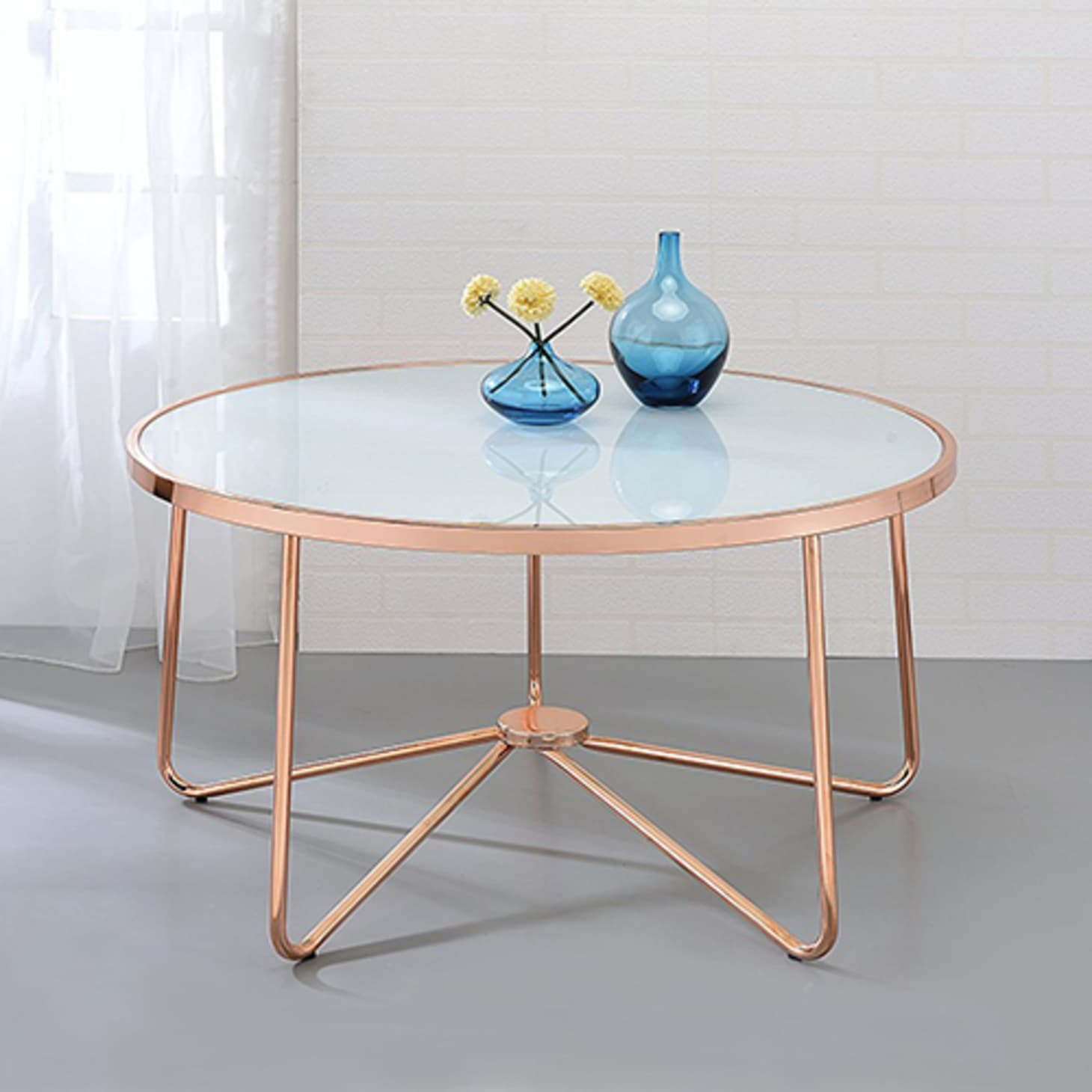 15 Stylish Modern Round Coffee Tables For Every Budget Apartment