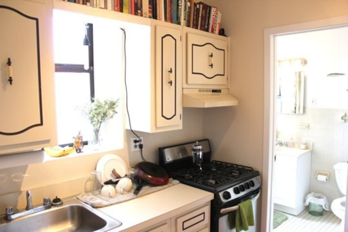 Amazing 7 Things To Do With That Awkward Space Above The Cabinets Download Free Architecture Designs Itiscsunscenecom