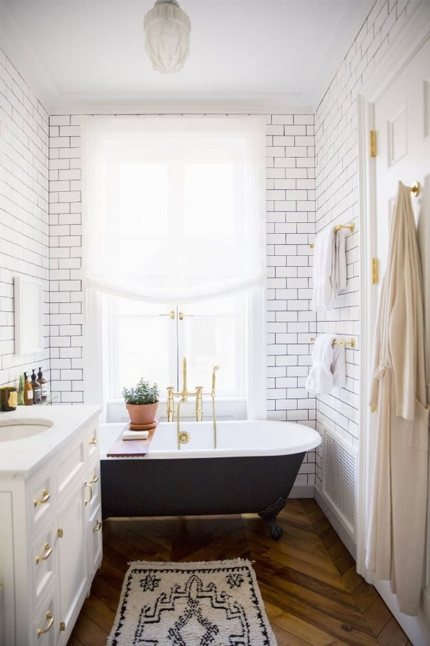 Black and White and Gold in the Bathroom | Apartment Therapy on white gold doors, white gold furniture, green bathroom, white gold photography, white gold beauty, white gold exterior, white gold bed, white gold car, white gold wedding, treasure island bathroom, white gold clothing, white gold room, white gold trap, white gold office, black bathroom, natural bathroom, pink bathroom, white gold closet, vintage bathroom,