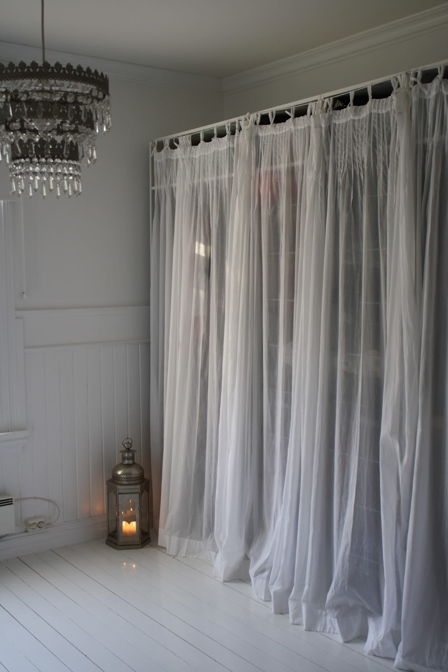 Project Ideas For Hiding Clutter With Curtains Amp Shades