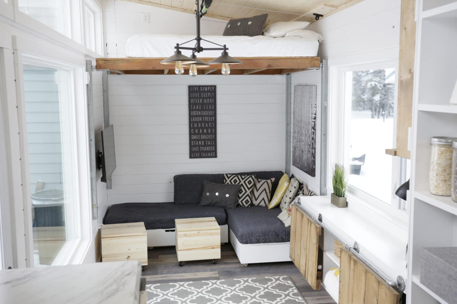 a tiny house with a unique  clever bedroom solution