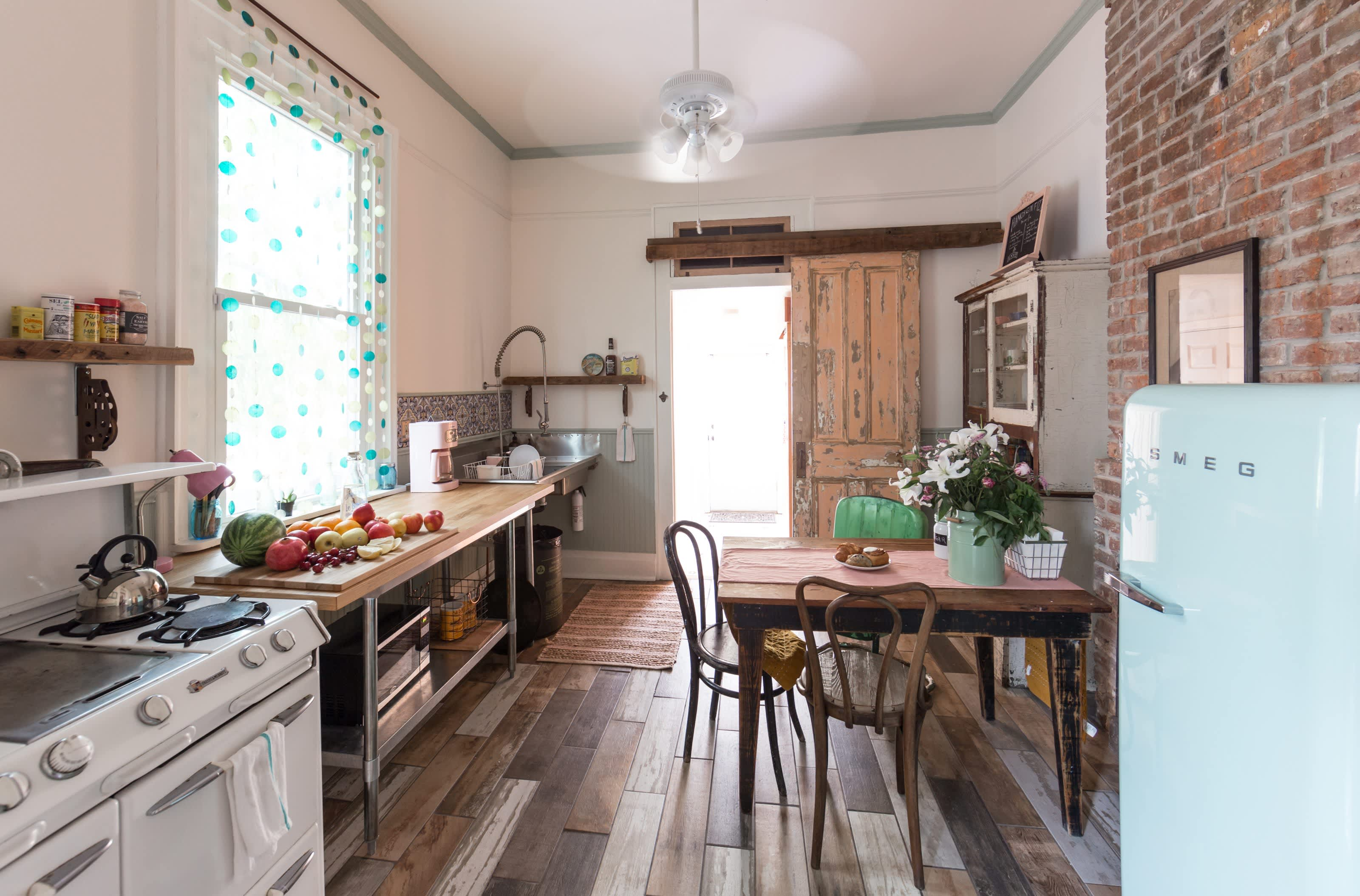 House Tour: A New Orleans Shotgun With Vintage Charm ... on cottage fireplace, a-frame house fireplace, tree house fireplace, victorian house fireplace,