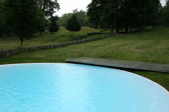 Modern Escape: Round Pool at The Glass House: gallery slide thumbnail 3