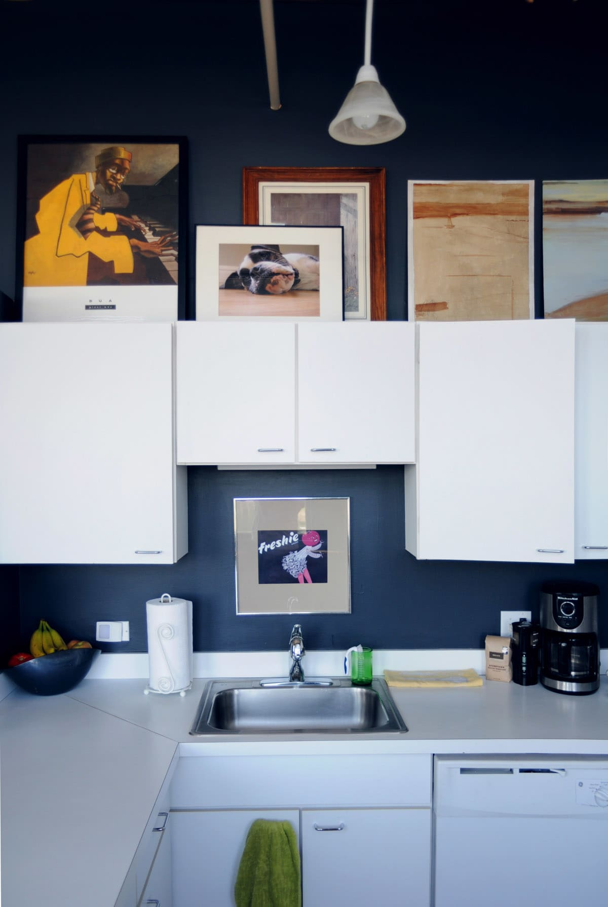 7 Things to Do with That Awkward Space Above the Cabinets ... on kitchen cabinet handles, kitchen counter edge profiles, kitchen counter televisions, kitchen counter spacers, kitchen counter walls, kitchen counter cleaning, kitchen counter bookcases, kitchen counter chandeliers, kitchen counter vinyl, kitchen counter furniture, kitchen counter shutters, kitchen cabinet styles, kitchen counter drawer, kitchen counter accents, kitchen counter edge styles, kitchen counter backsplash, kitchen countertops, kitchen counter concrete, kitchen counter slabs, kitchen counter doors,