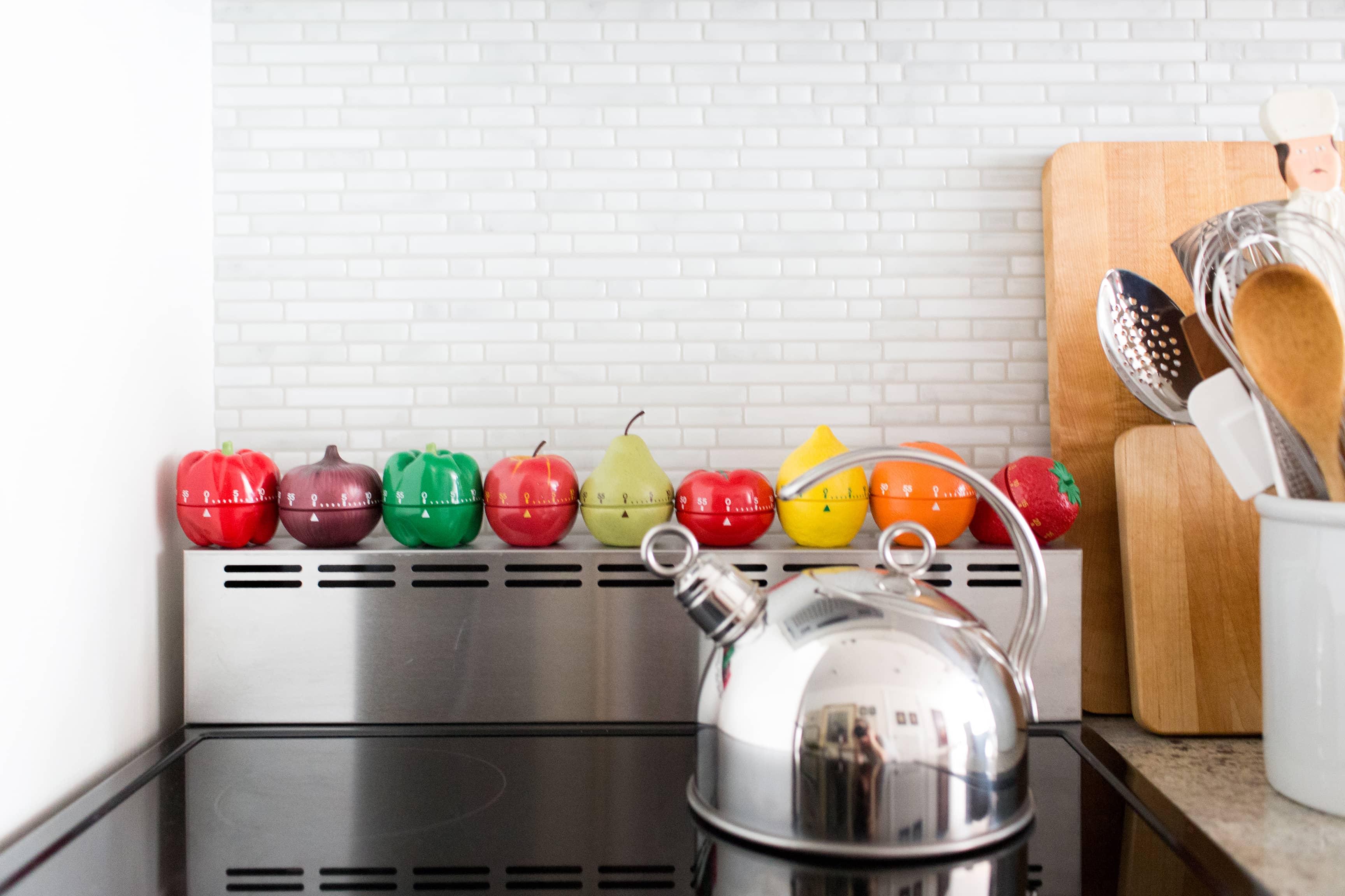 8 Ways to Cover an Old Tile Backsplash You | Apartment Therapy Ugly Kitchen Tile Backsplash on ugly kitchen counters, ugly kitchen cabinets, ugly kitchen flooring, ugly kitchen lighting, ugly kitchen sink, ugly kitchen faucets, ugly kitchen appliances,