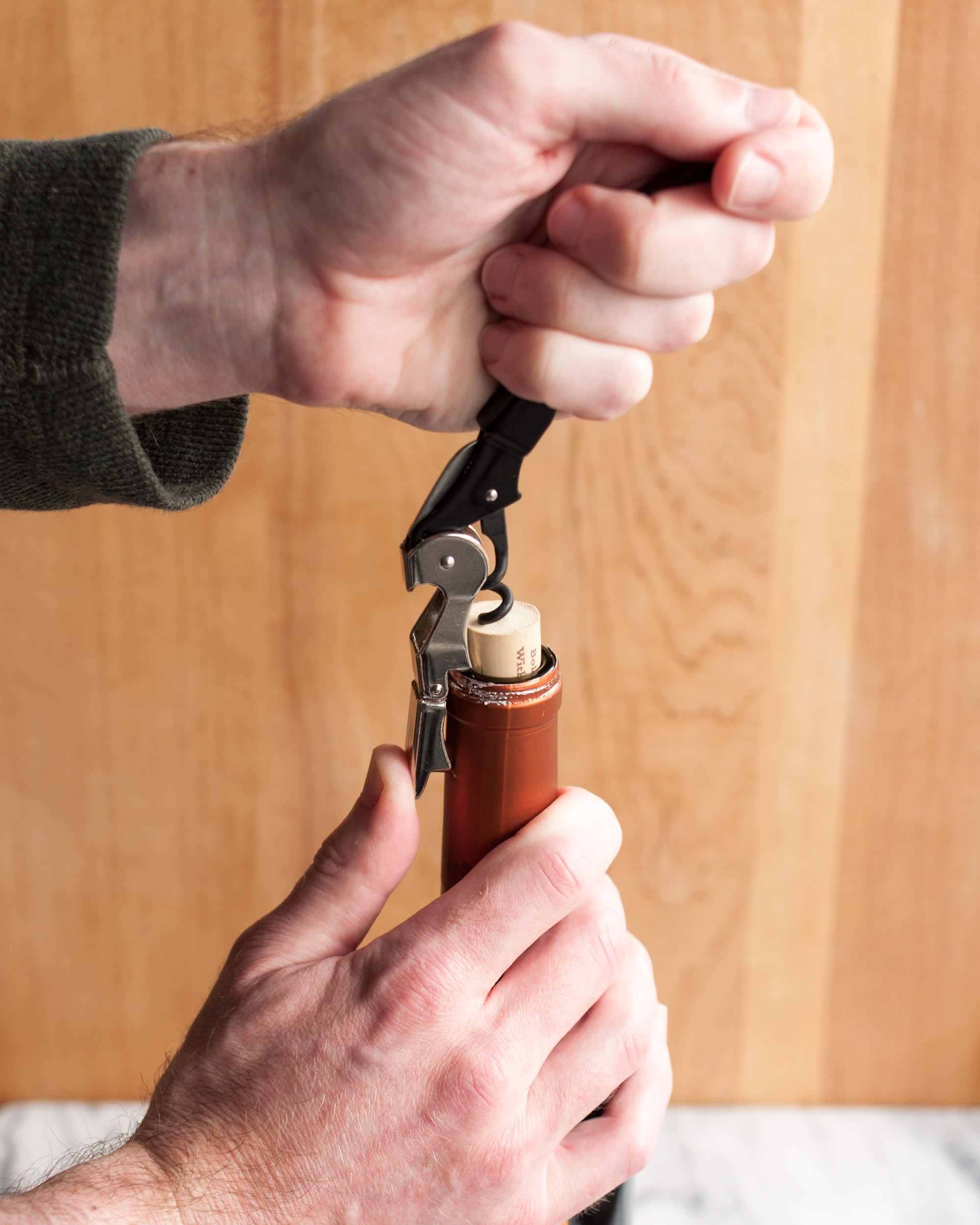 How To Open a Bottle of Wine Using a Wine Key Corkscrew: gallery image 8