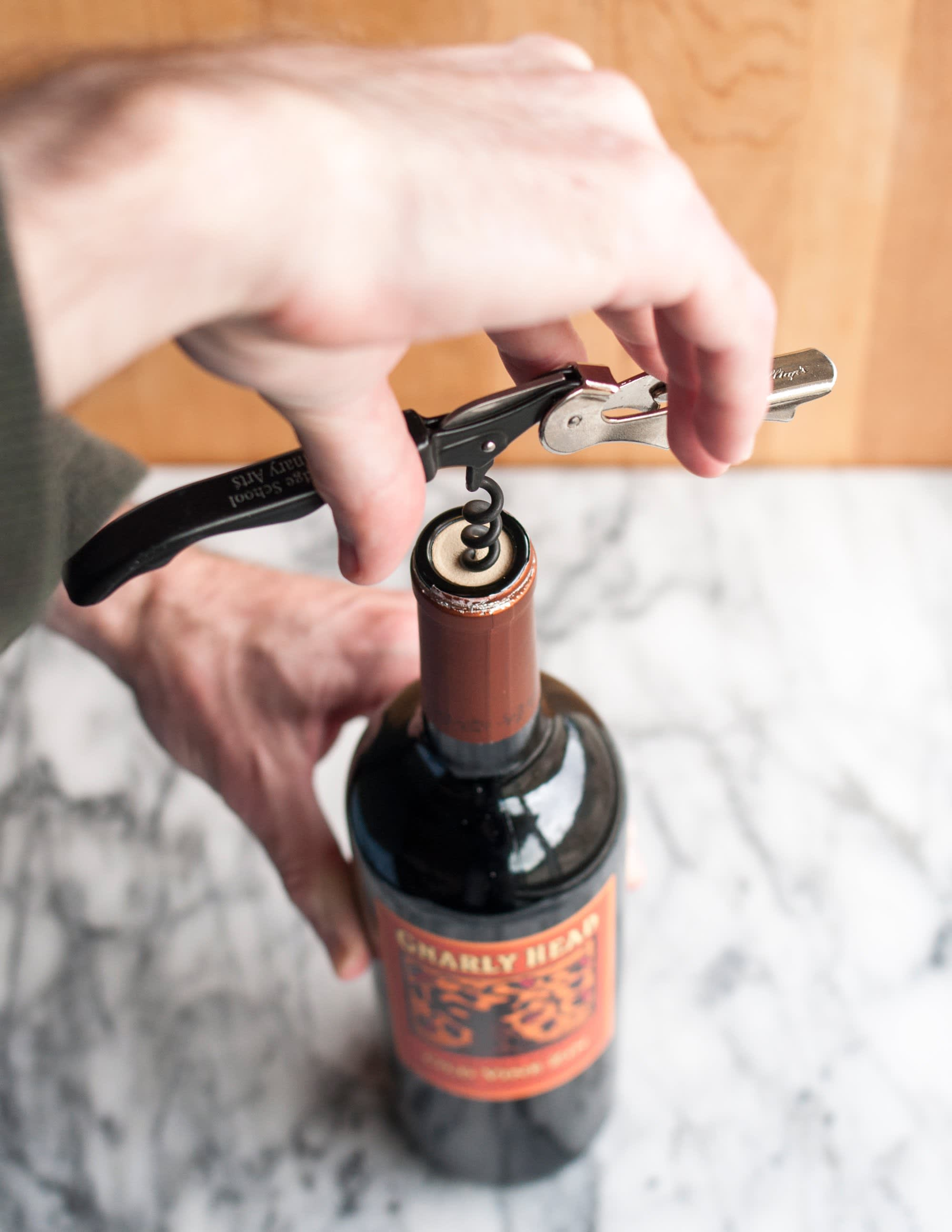 How To Open a Bottle of Wine Using a Wine Key Corkscrew: gallery image 6