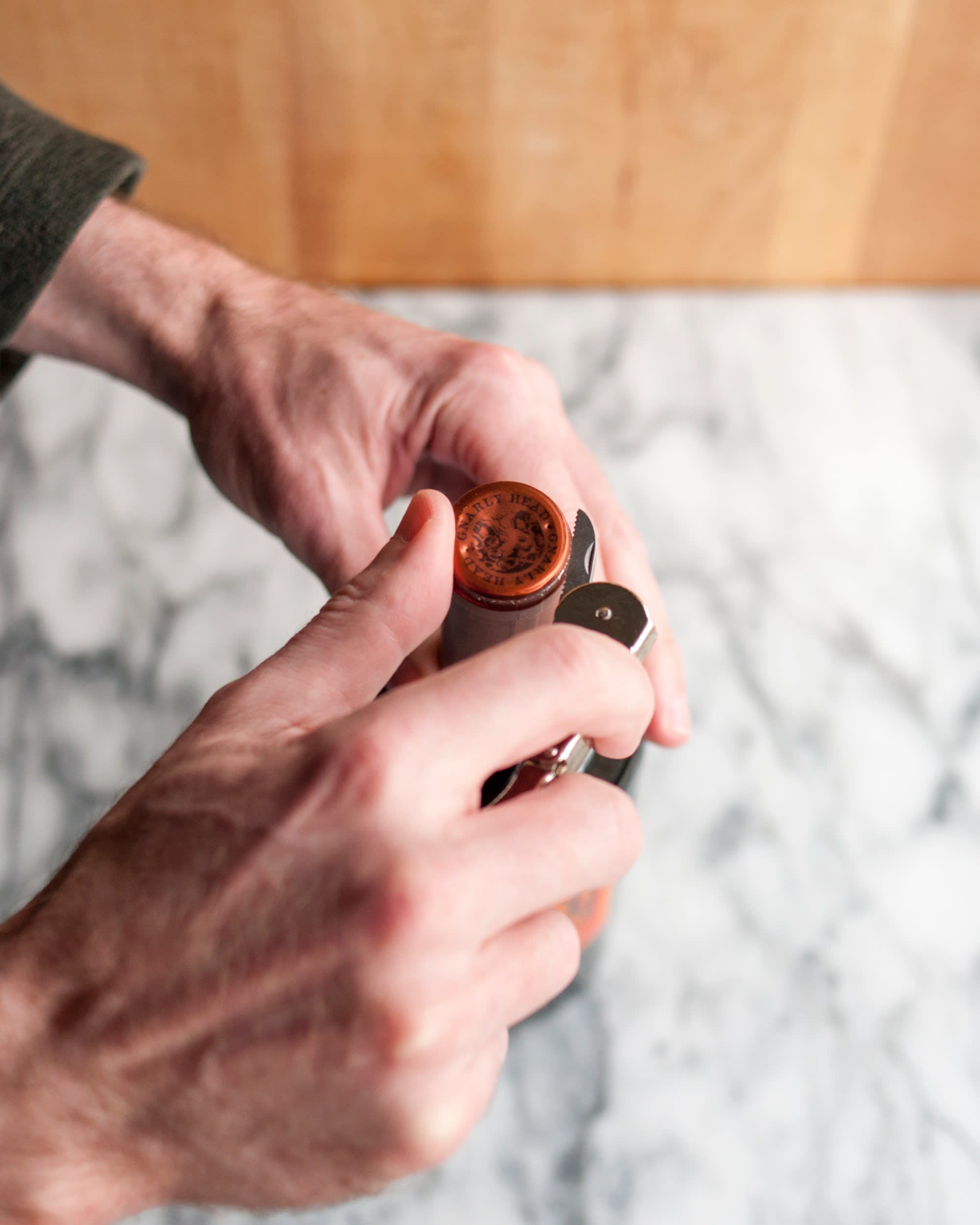 How To Open a Bottle of Wine Using a Wine Key Corkscrew: gallery image 2