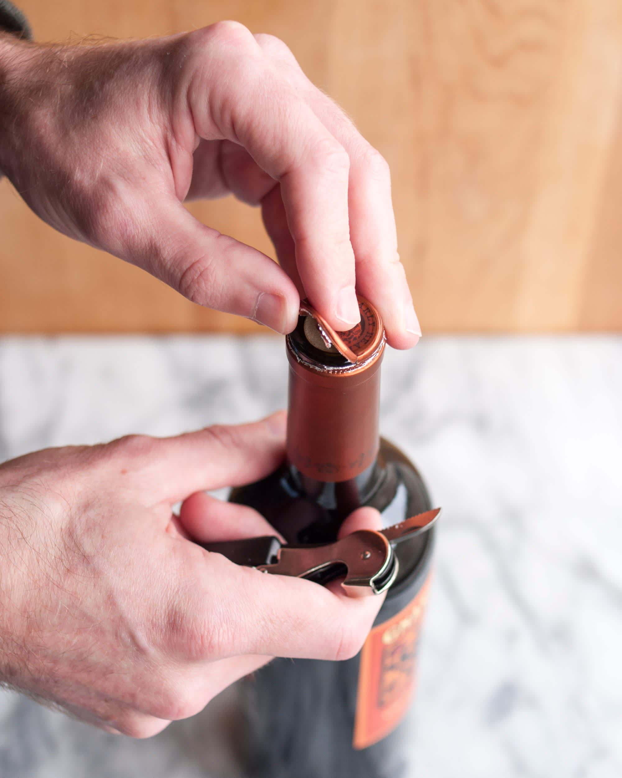 How To Open a Bottle of Wine Using a Wine Key Corkscrew: gallery image 3