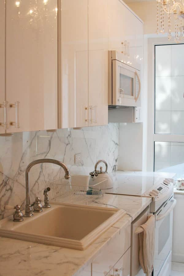 Dixie's Sleek White Kitchen (with Closeted, Colorful Charm!): gallery image 3