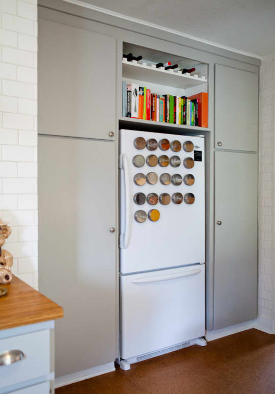 Magnetic spice racks on a refrigerator door.