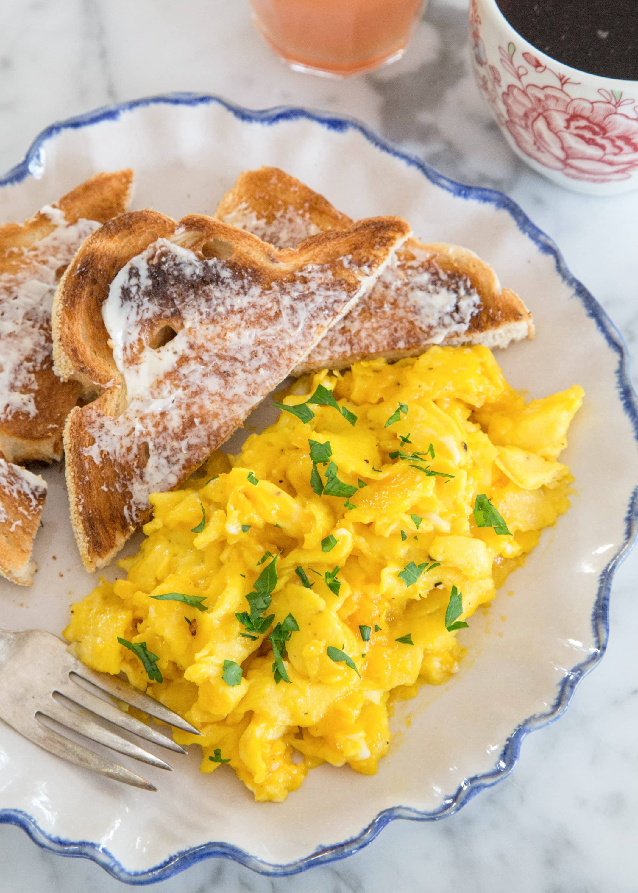 Scrambled eggs and toast on a plate