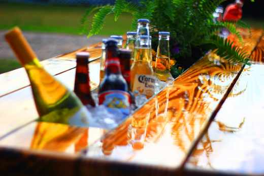 The Best Thing Ever for an Outdoor Party? Beer and Wine Gutter Picnic Tables: gallery image 1