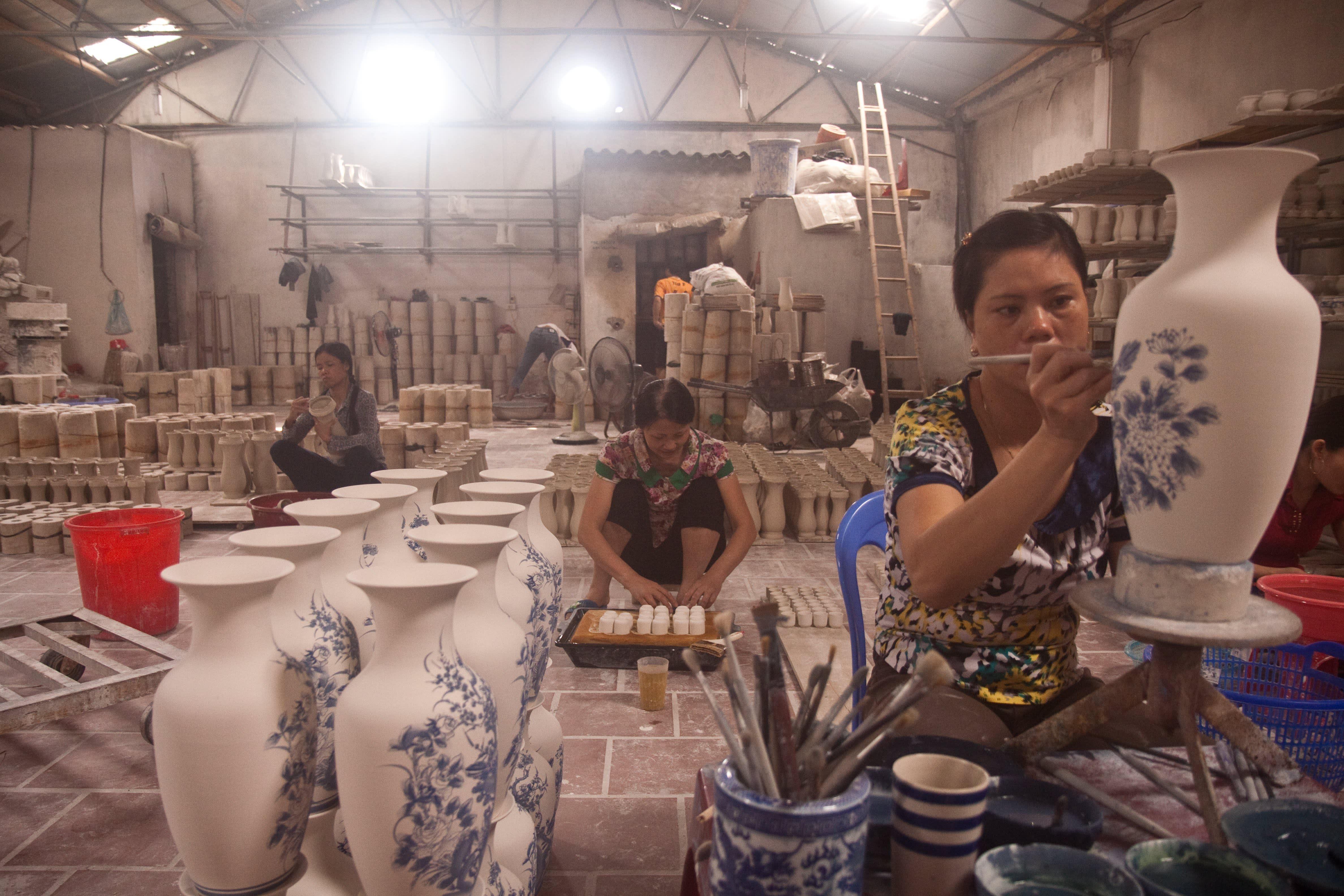Visit the Ancient Village of Bat Trang, Vietnam, Where Everyone Makes Pottery: gallery image 12