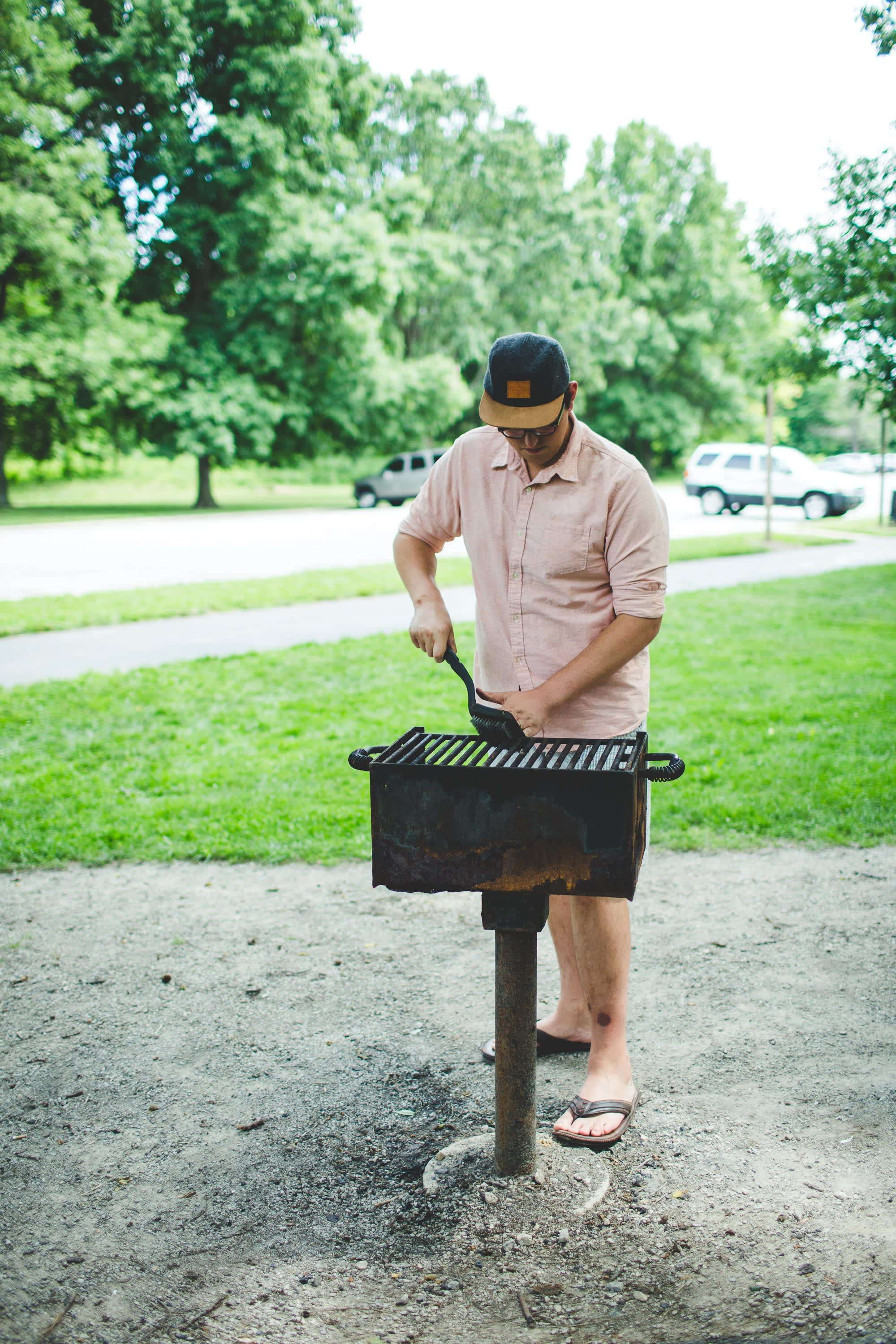 Cleaning a park grill.