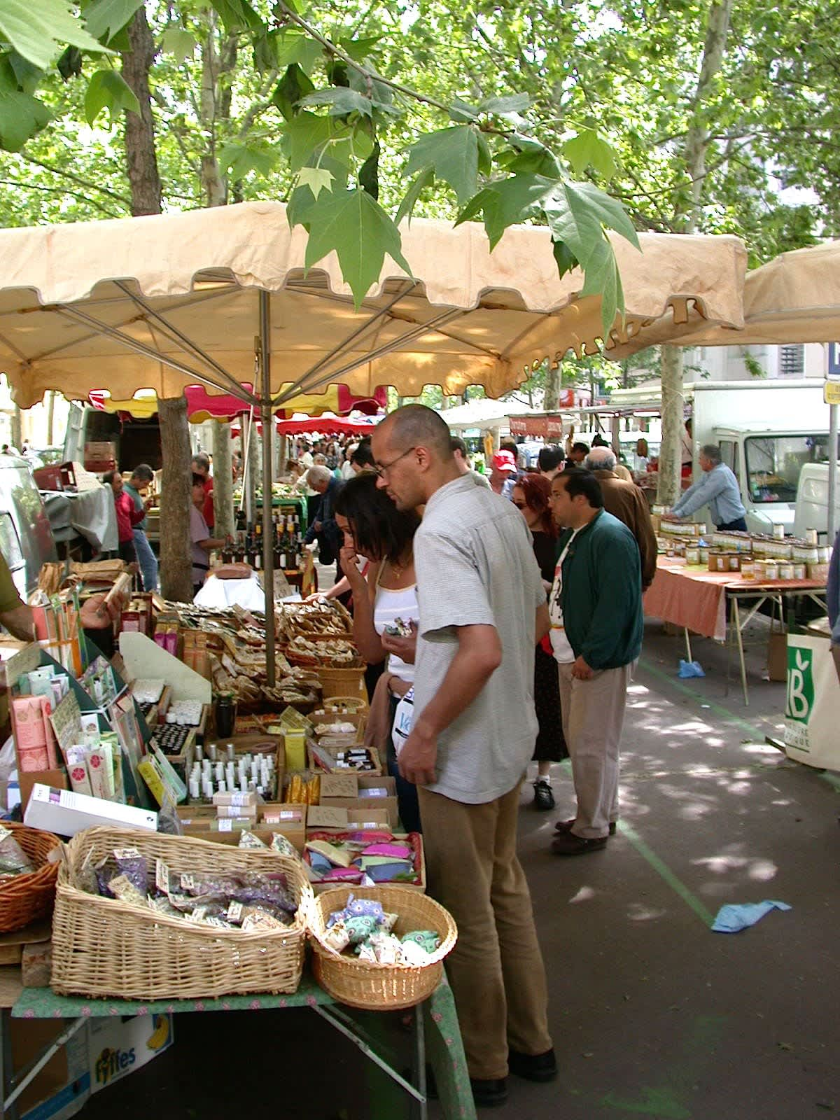 Man Picking Produce at a French Farmers Market