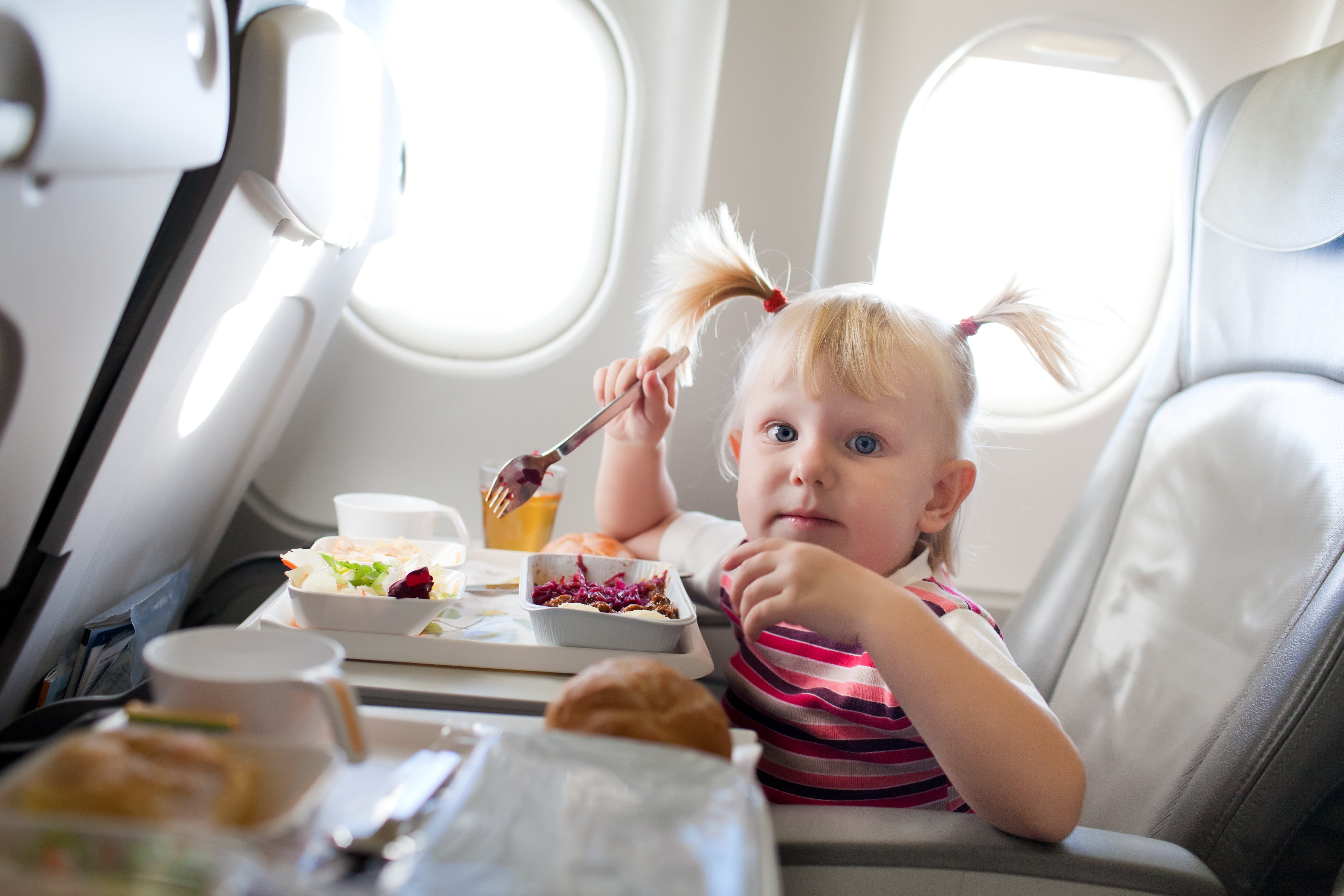 Little Girl Eating on an Airplane