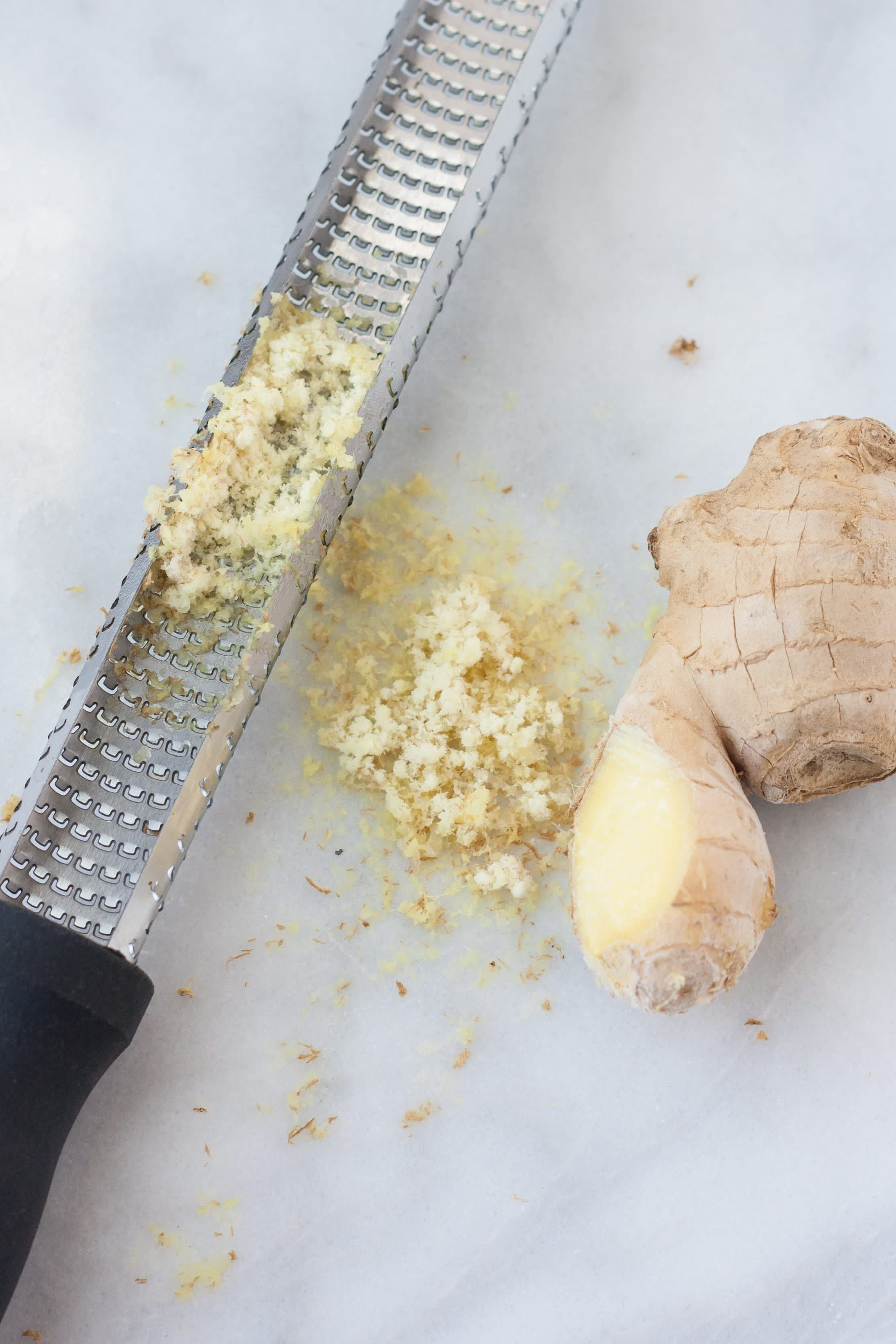 Frozen ginger grated on a Microplane