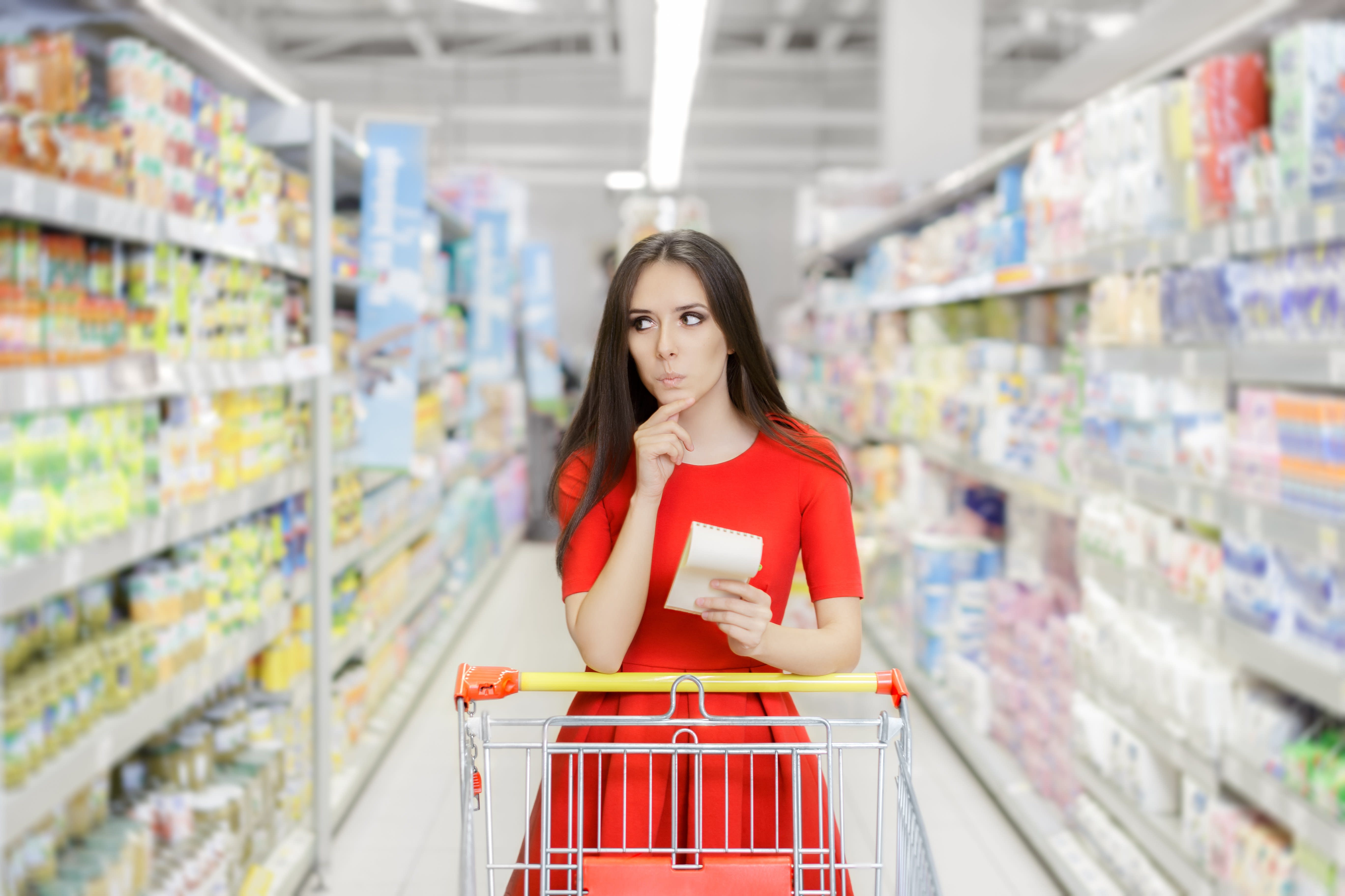 Woman Contemplating Something in Grocery Store Aisle