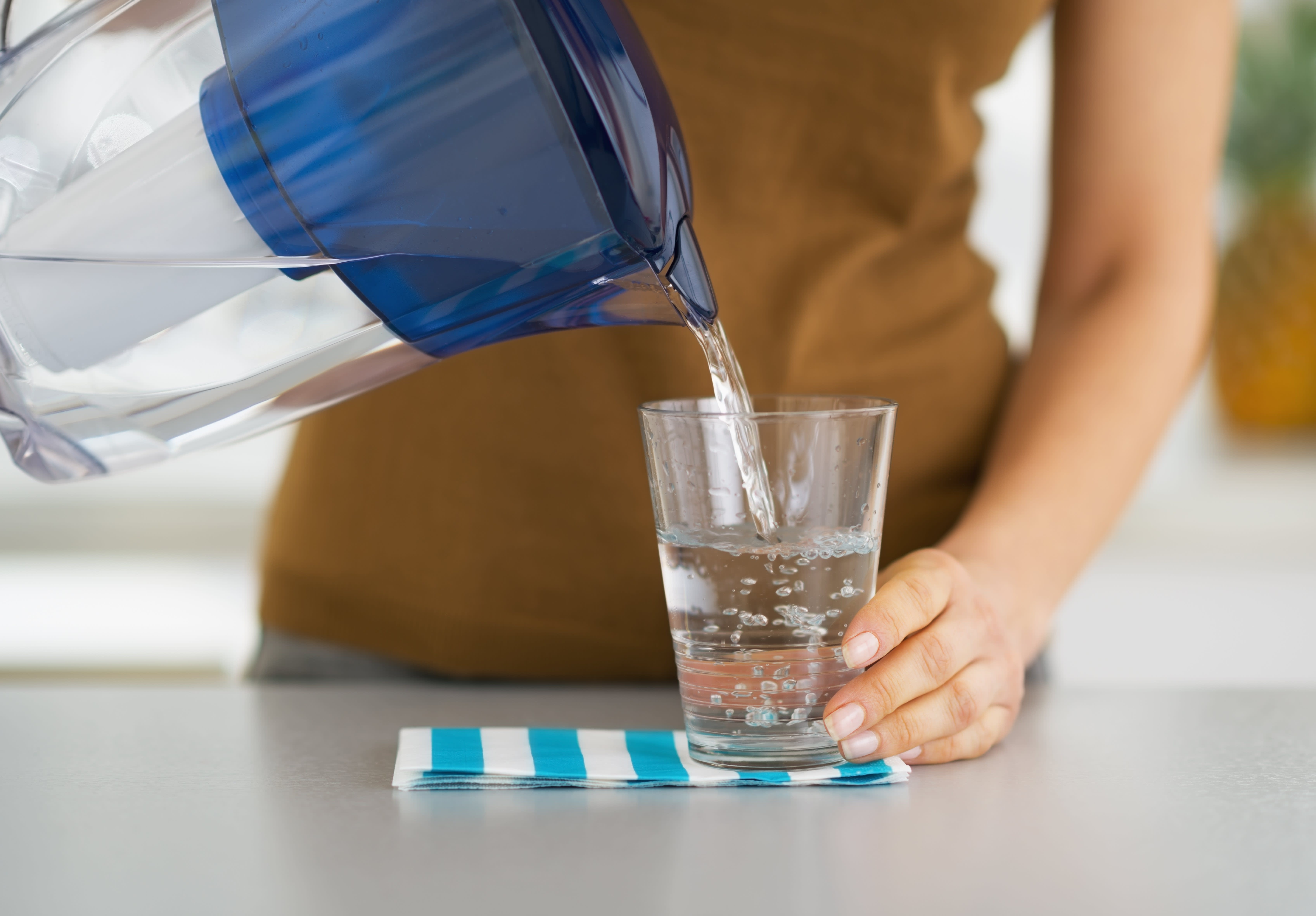 Pouring a Glass of Water from a Pitcher
