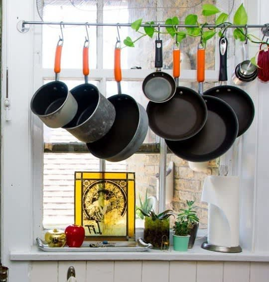 Pots and pans in front of a kitchen window
