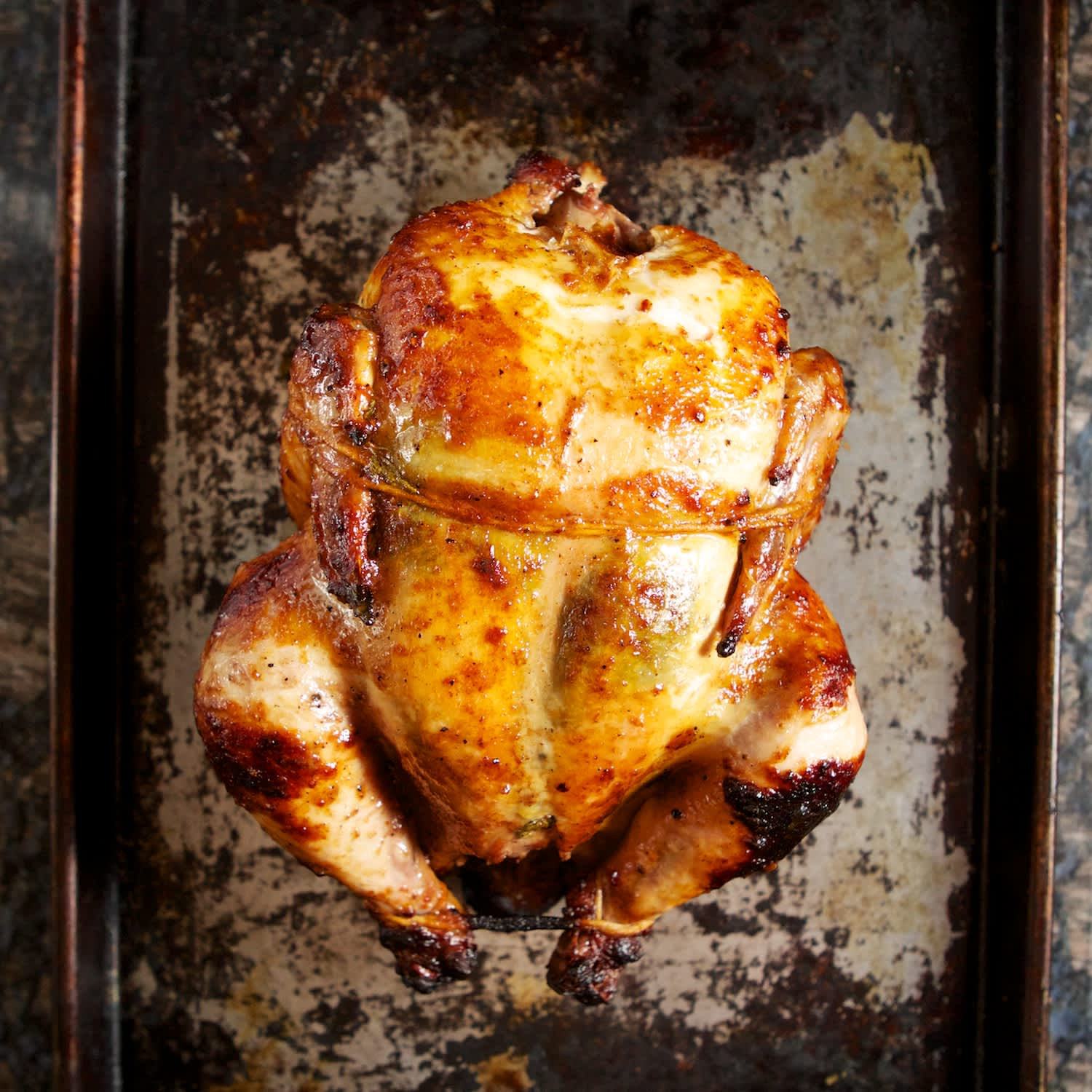 How To Cook a Crispy, Juicy Rotisserie Chicken on the Grill