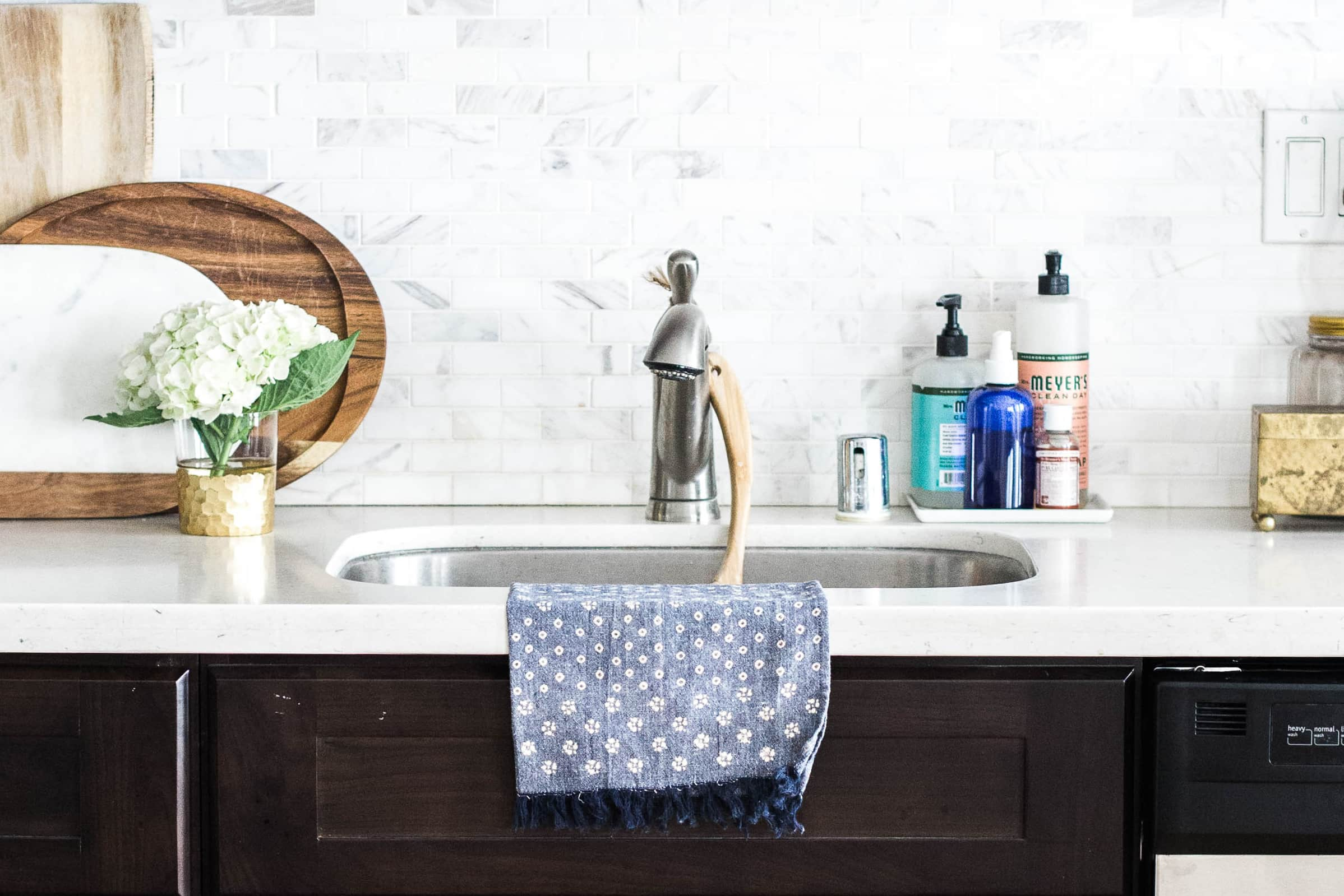 Sink with cloth and cleaning supplies