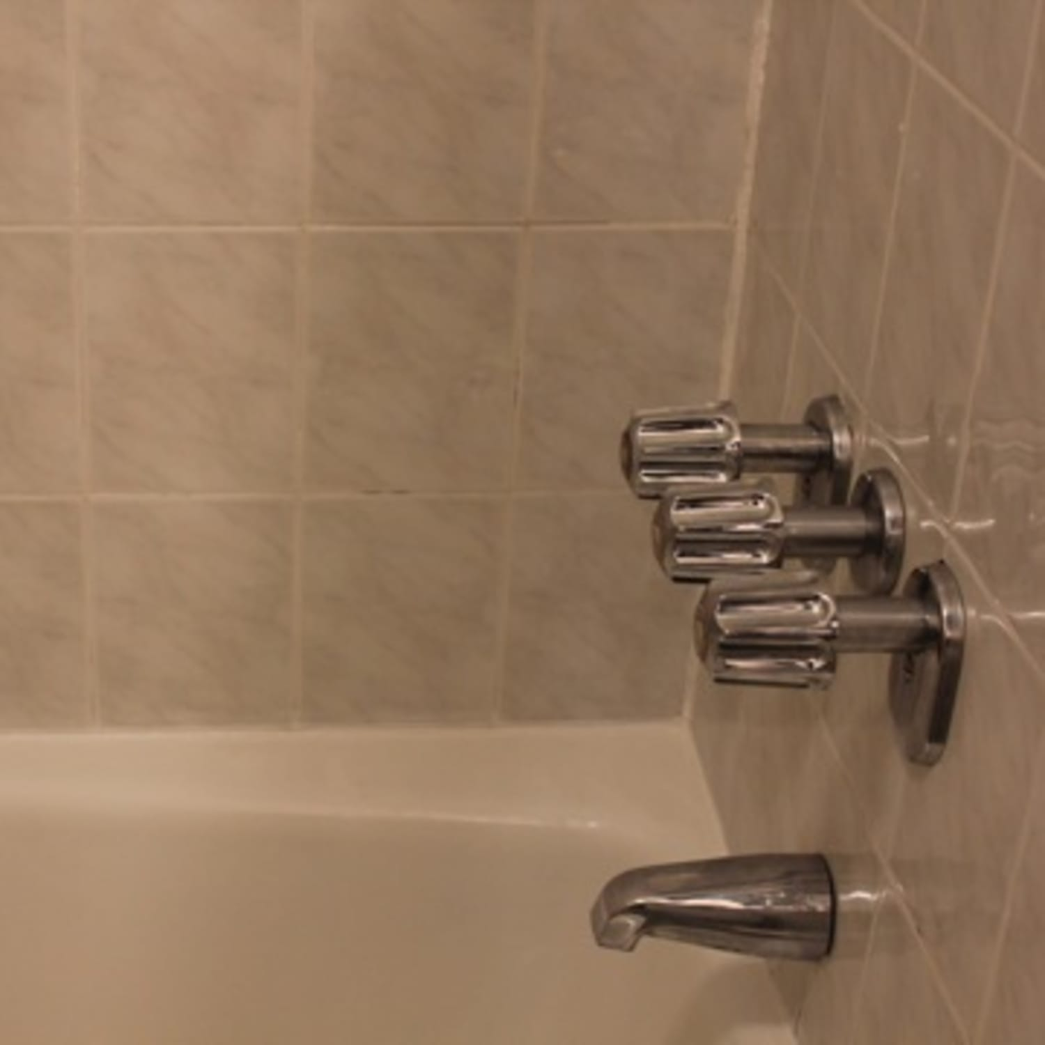 How Long Does Caulking Take To Dry In A Bathroom how to recaulk a bathtub | apartment therapy