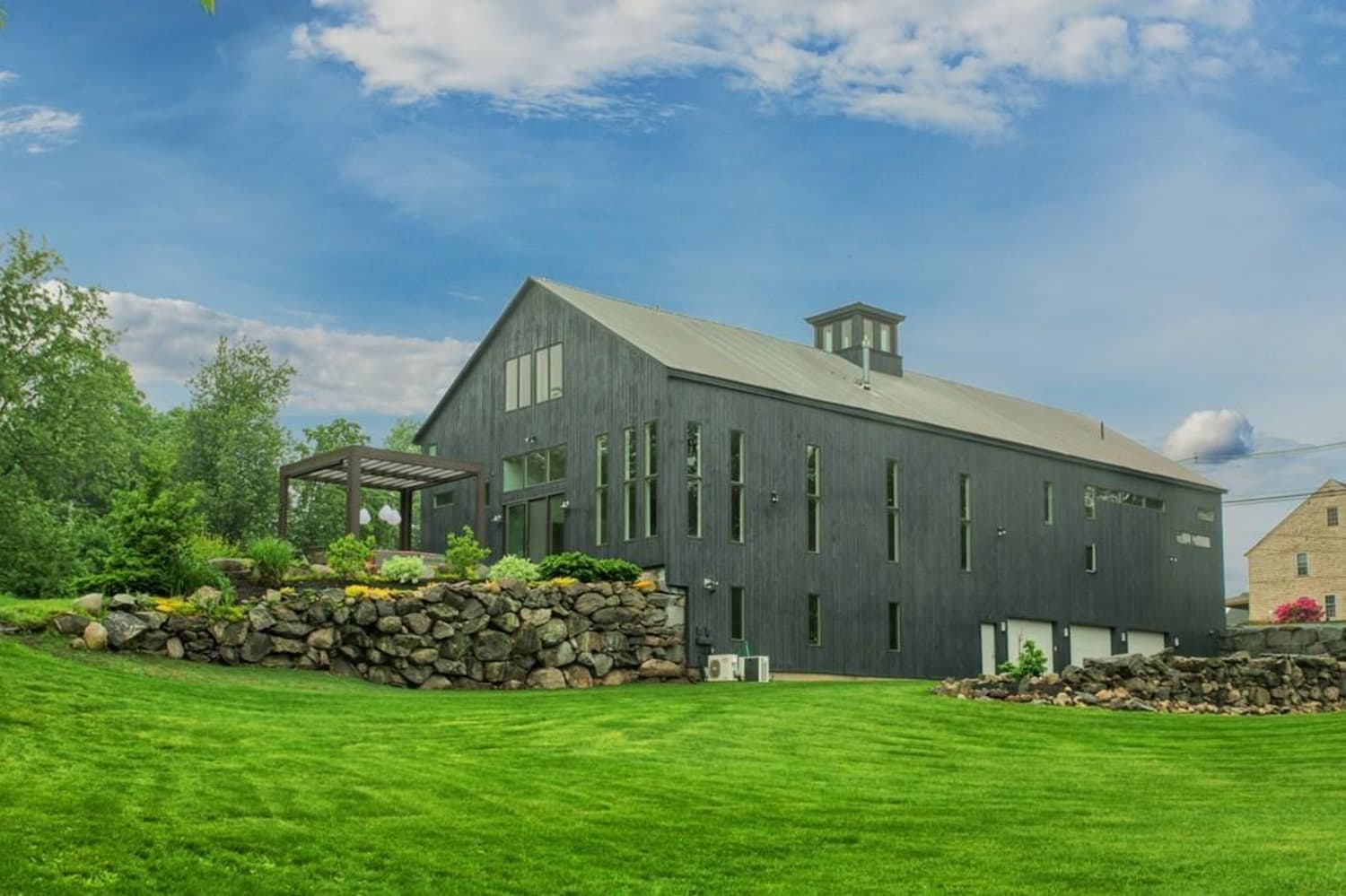 No Shiplap In Sight In This $925K Modern Barn Conversion
