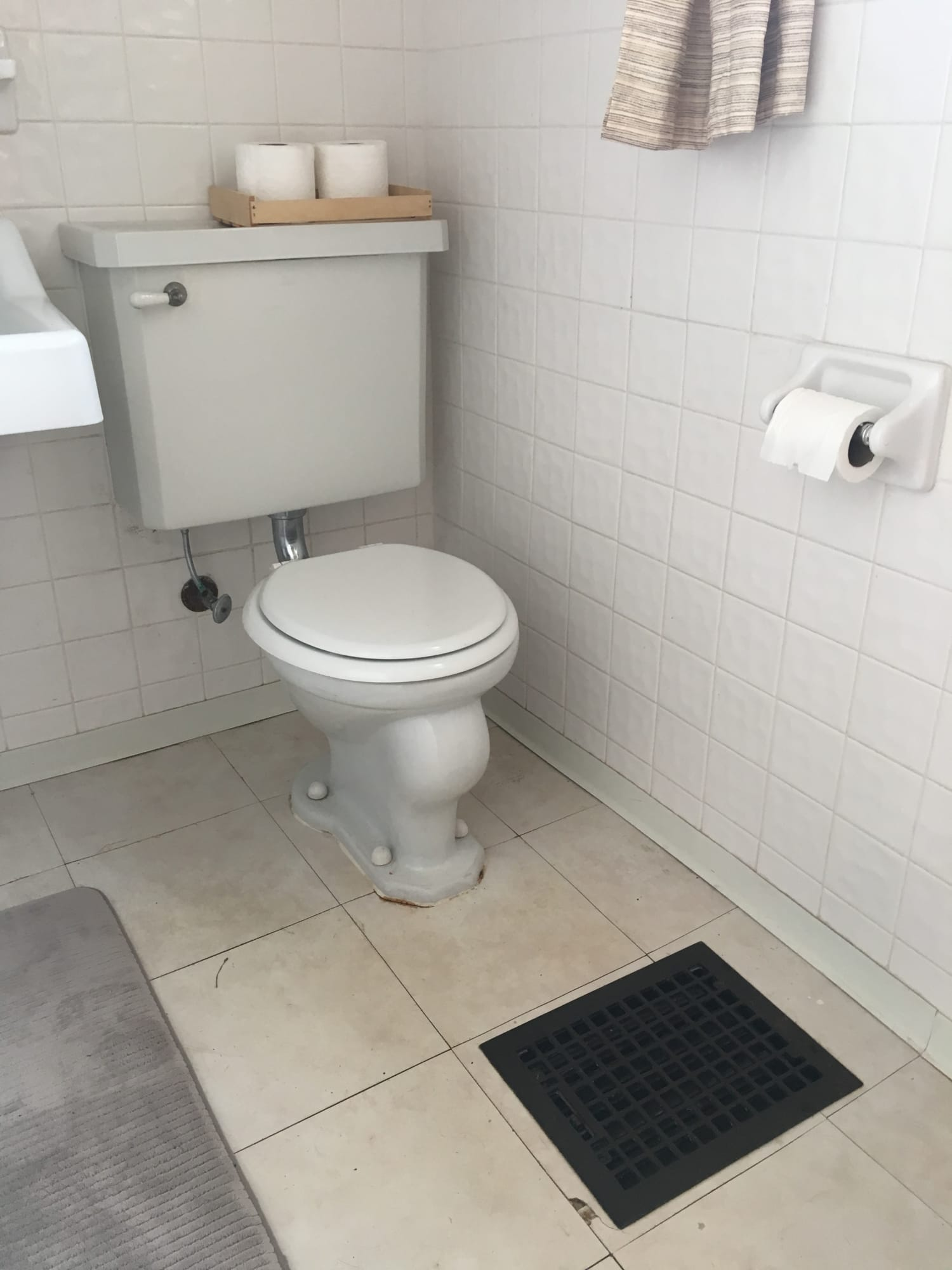 This $50 Temporary Flooring Floats Right Over Rental Bathroom Tile